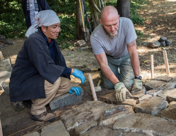 Instructor and student working on stone path