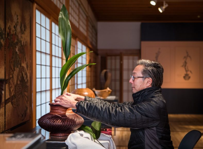 David Komeiji arranging ikebana for Hanakago Art in the Garden exhibition