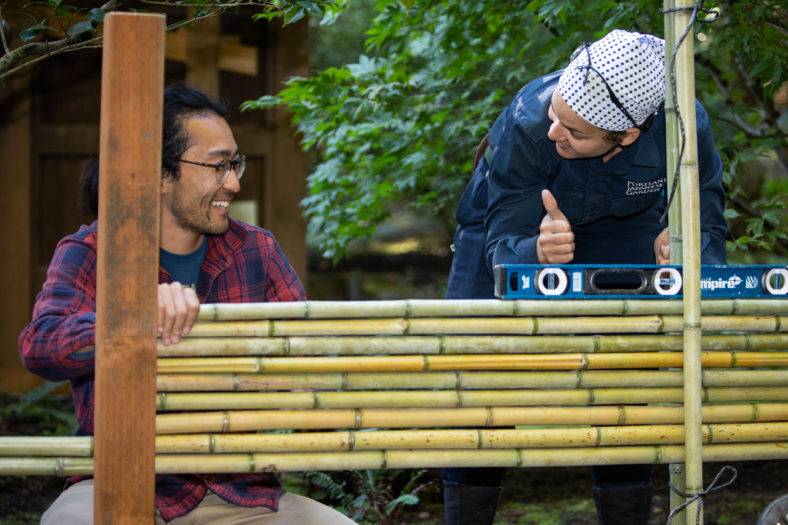Gardener gives student thumbs up at bamboo workshop